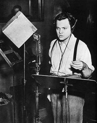 Orson Welles in the CBS Radio studio.